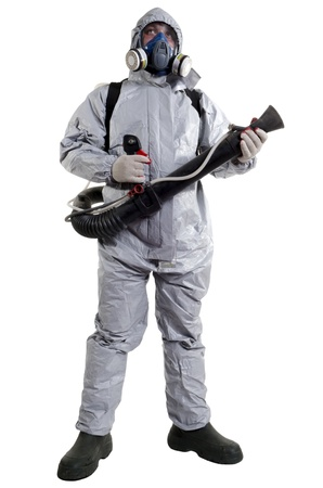 zipped: A pest control worker wearing a mask to help exterminate rats and other vermin  Stock Photo