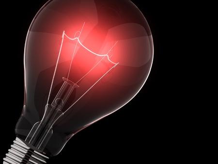 filaments: Red light bulb against black background