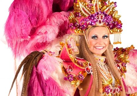 Portrait of young woman in pink carnival costume, close up Stock Photo