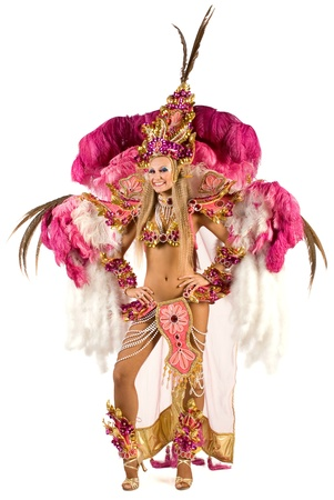 Portrait of young woman in pink carnival costume photo