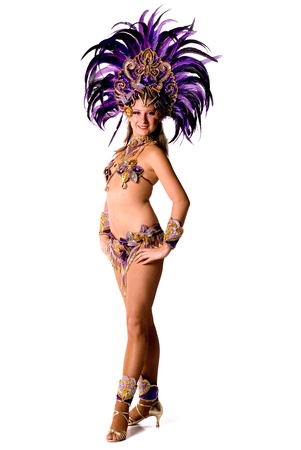 Portrait of young woman in violet carnival costume, close up photo