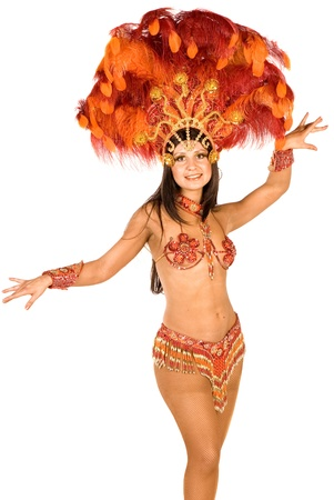 Portrait of young woman in orange carnival costume, close up