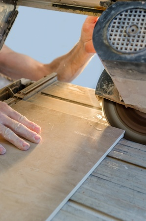 A wet saw cutter is being used to cut floor tile Stock Photo - 20443291