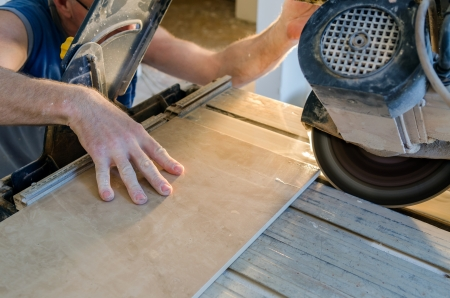 motor home: A wet saw cutter is being used to cut floor tile Stock Photo