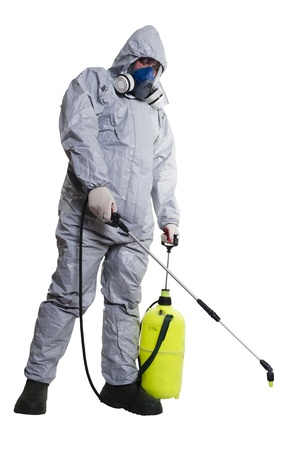 disease control: A pest control worker wearing a mask, hood, protective suit and dual air filters holding a hose to help exterminate rats and other vermin  Stock Photo