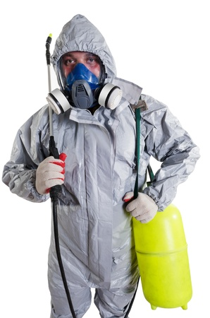 radiation pollution: A pest control worker wearing a mask, hood, protective suit and dual air filters holding a hose to help exterminate rats and other vermin  Stock Photo
