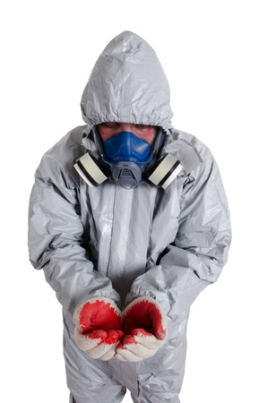 zipped: A pest control worker wearing a mask, hood, protective suit and dual air filters holding a hose to help exterminate rats and other vermin  Stock Photo