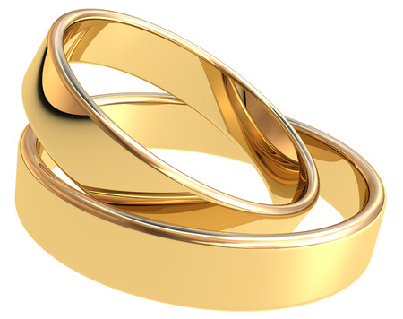 Gold wedding rings on white background photo