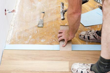 building contractor: Home improvement, new floor installation Stock Photo