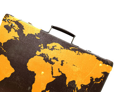 globetrotter: Old suitcase globetrotter with a world map  Stock Photo