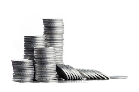 Silver coins in high stacks photo