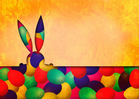 A shape of an Easter bunny on Easter eggs on a gold backround photo