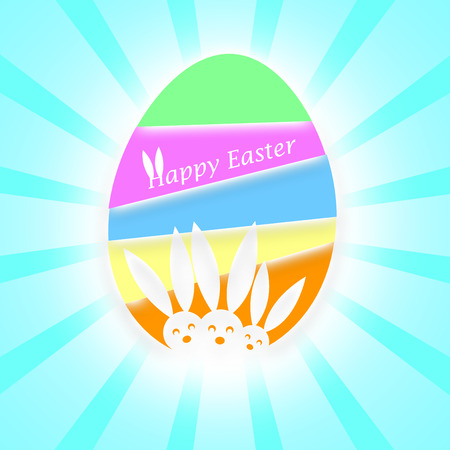 Three heads of Easter bunnies on a colorful Easter Egg on a light rays background photo