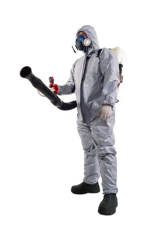 A pest control worker wearing a mask, hood, protective suit and dual air filters holding a hose to help exterminate rats and other vermin.