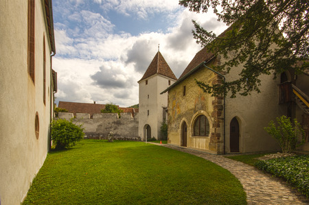 fortify: The fortified church of St. Arbogast, serving the local evangelical community, was built in the late Middle Ages. Its surrounding seven metre tall ramparts built in the 15th century are still intact. A charnal house was built adjoining the church in the 1