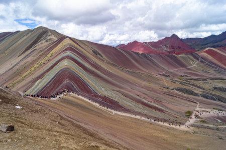 Vinicunca, or Winikunka, also called Montaña de Siete Colores, Montaña de Colores or Rainbow Mountain. Tourists come upstairs