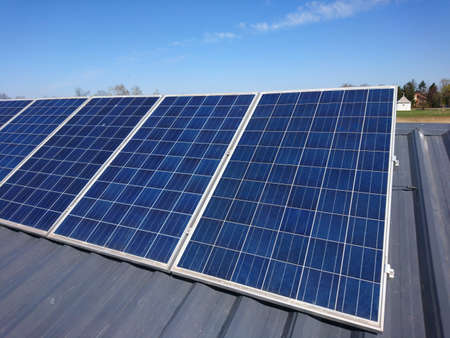 Solar panels on the roof. Sunny day. Clear blue sky.