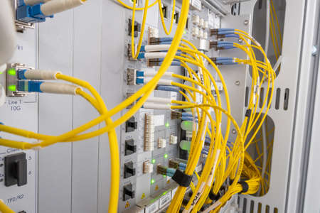 Patch panel of fiber optic network cables. Fiber optic installation in a rack