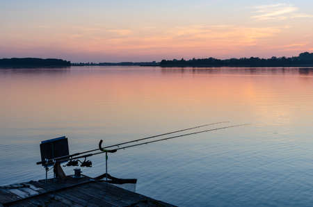 fishing equipment on the pier at the lake in Masuria. The pier, the quiet ÅšwiÄ™cajty lake, sunset