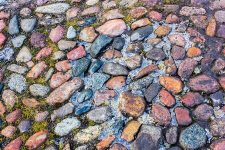 stone road: Colourful stone road with ice between stones