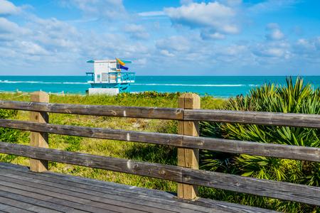 Wooden pier to lifeguard booth of Miami beach Florida