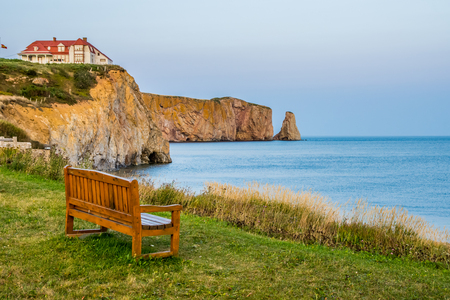 Bench in front of the pierced rock and sea