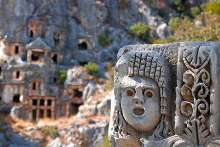 Ancient lycian Myra rock tomb ruins in Demre, Antalya.