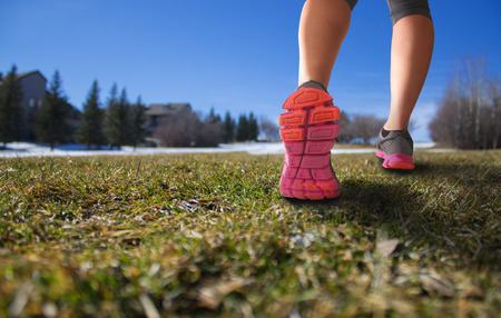 pair of legs walking up a big hill in early spring with a shallow depth of field with space for copy