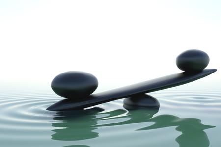 piedras zen: Una piedra de equilibrio en un agua de zen  Foto de archivo