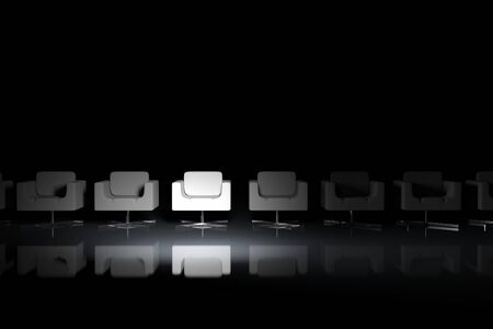 White armchairs on a black background with light effect Stock Photo