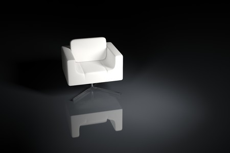 A white armchair on a black background and illuminated by a light