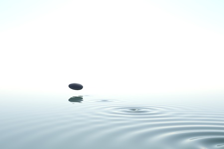zen stone thrown on the water on white background Banco de Imagens