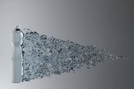 Bottle of water splashing on a gray background