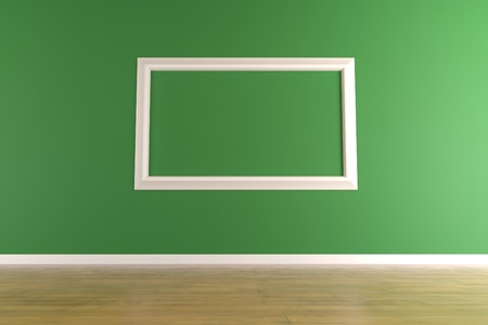 Empty and white picture frame isolated on a green wall