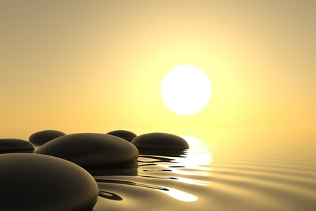 Zen stones into the water with sunset on background Banco de Imagens
