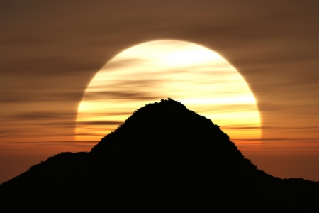 A mountain shape with sunset on the background