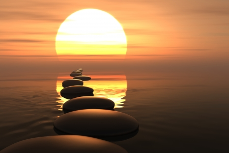 'peace of mind': Zen stones into the water with sunset on the background Stock Photo