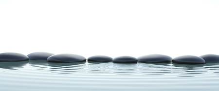 meditation stones: Zen stones in water on widescreen with white background Stock Photo