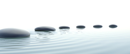 zen water: Zen stones in water on widescreen with white background Stock Photo
