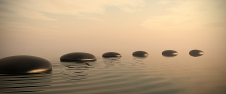 ways: Zen stones into the water with sunrise on the background