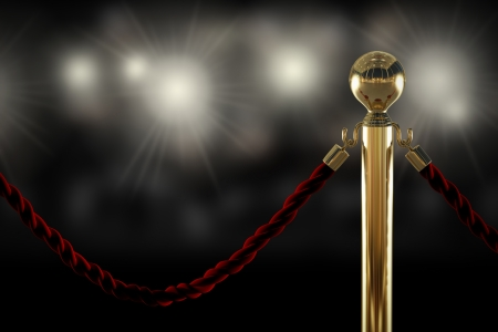 reserved: Red velvet rope barrier close-up with flash light on background Stock Photo