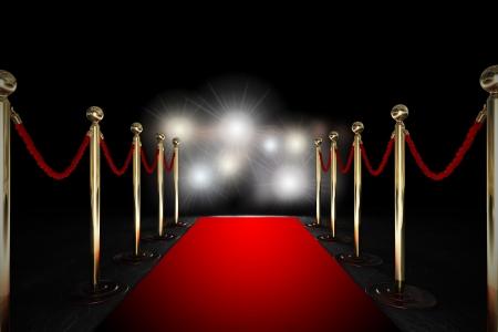 premios: Alfombra roja entre dos barreras de cuerda y luz intermitente Foto de archivo