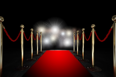 fame: Red carpet between two rope barriers and flash light Stock Photo
