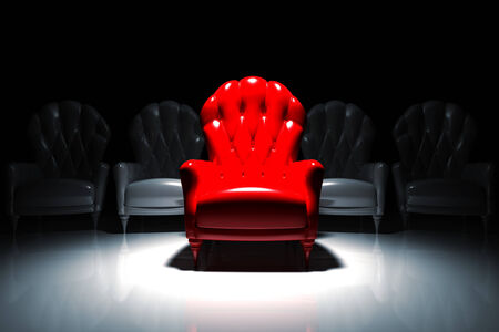Red armchair illuminated in front of camera with gray armchairs behind it