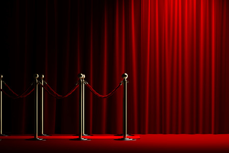 Velvet red rope barrier with a shining curtain on the right Stock Photo