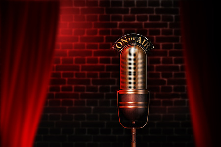 Old mic on air behind a curtain with red lights and wall on the background photo