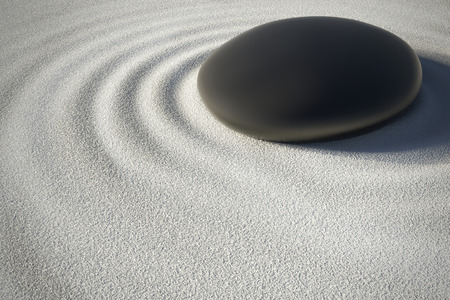 spirituality therapy: black stone on sand with its harmonious ripples