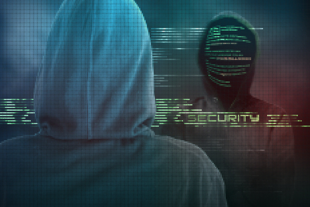 A internet specialist makes your computer safe from criminal cyber-attacks, using a green pixelated firewall Standard-Bild