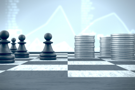 Chess pawn in front of money stacks on a blue financial background 스톡 콘텐츠