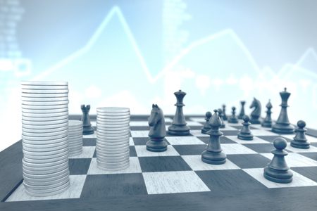 Finance concept: Money stacks attacked by black chess pieces on a blue background stocks Banco de Imagens